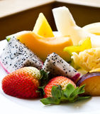 Fresh fruits. Fresh assorted and colorful cut fruits stock image