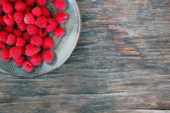 Fresh fruits background with raspberries Stock Photography