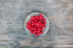 Fresh fruits background with raspberries Stock Photos