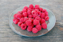 Fresh fruits background with raspberries Royalty Free Stock Images