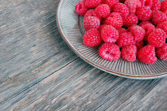 Fresh fruits background with raspberries Royalty Free Stock Photo