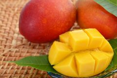 Fresh tropical fruits. Fresh fruits on a bamboo mat royalty free stock images