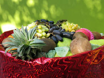 Fresh Fruits Basket. A basket full of fresh fruits like grapes, pineapple, pear, chickoo and others Stock Photos