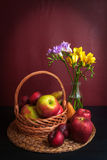 Fresh Fruits Basket and Flowers Stock Photography