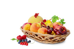 Fresh fruits in a basket. Isolated on white background Royalty Free Stock Photography