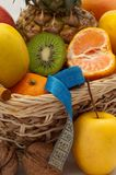 Fresh  fruits in a basket with a measuring tape Royalty Free Stock Photography