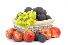 Fresh fruits in a basket Stock Photos