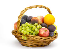 Fresh fruits in a basket. On white background stock image