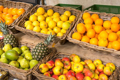 Fresh fruits in baskets at a market Stock Photo