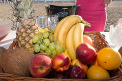 Fresh Fruits on the beach at a deck. Assorted tropical fruits Royalty Free Stock Photography