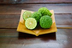 Fresh fruits bergamot with cut in half. On wood table stock photo