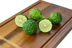 Fresh fruits bergamot with cut in half isolated. White background stock photos