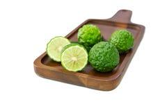 Fresh fruits bergamot with cut in half on wood. Isolated white background royalty free stock photos
