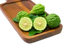 Fresh fruits bergamot with cut in half on wood. Isolated white background royalty free stock photography