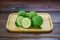 Fresh fruits bergamot with cut in half. On wood table royalty free stock photo