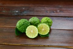 Fresh fruits bergamot with cut in half. On wood table stock images