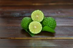 Fresh fruits bergamot with cut in half. On wood table royalty free stock images