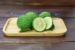 Fresh fruits bergamot with cut in half. On wood table stock photos