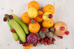 Fresh fruits and berries isolated on white Royalty Free Stock Images