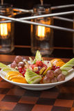 Fresh fruits and berries on a plate Stock Images