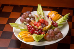 Fresh fruits and berries on a plate Stock Photography