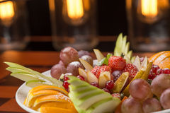 Fresh fruits and berries on a plate Stock Photos