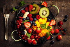 Fresh fruits and berries on plate Royalty Free Stock Images