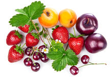 Fresh fruits and berries in still life with green leaves Royalty Free Stock Photography