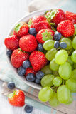 Fresh fruits and berries. strawberry blueberry grape Stock Photo