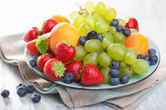 Fresh fruits and berries. strawberry blueberry grape apricot Royalty Free Stock Photo