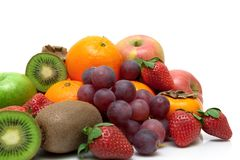 Fresh fruits and berries on a white background Royalty Free Stock Image
