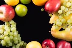 Fresh fruits. On black background Stock Images