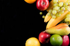 Fresh fruits on black background. Top view Stock Image