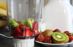 Fresh fruits in the blender Royalty Free Stock Images