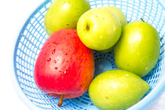 Fresh Fruits. In blue basket Royalty Free Stock Photography