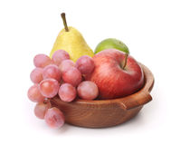 Fresh fruits  in a bowl. White background Royalty Free Stock Images
