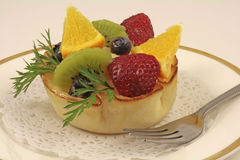 Fresh fruits bowl cake. A summer dessert: fresh fruits bowl cake on white background royalty free stock photos