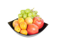 Fresh fruits in a bowl isolated  on white Stock Photos