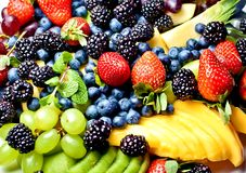 Fresh fruits in a bright setting. Stock Images