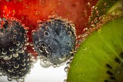 Fresh fruits swim in the water royalty free stock photography