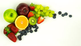Fresh fruits. A bunch of fresh fruits in the spotlight stock photos