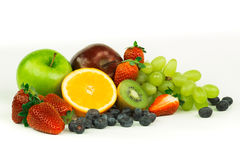 Fresh fruits. A bunch of fresh fruits in the spotlight stock photo
