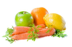 Fresh fruits and carrot   on a white background Stock Photos