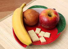 Fresh fruits and chocolate. Fresh fruits and white chocolate in a bowl Royalty Free Stock Photography