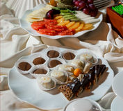 Fresh fruits and chocolate candies Stock Images