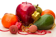 Fresh fruits and Christmas toys Stock Photos