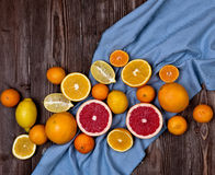 Fresh fruits citruses on a dark wooden background. Raw and vegetarian eating frame. Royalty Free Stock Photo