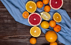 Fresh fruits citruses on a dark wooden background. Raw and vegetarian eating frame. Stock Photo