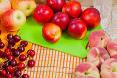 Fresh fruits and colored cutting boards Stock Photography