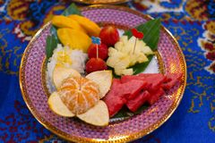 Fresh fruits. Colorful Fresh Fruits on Ceramic plate stock images